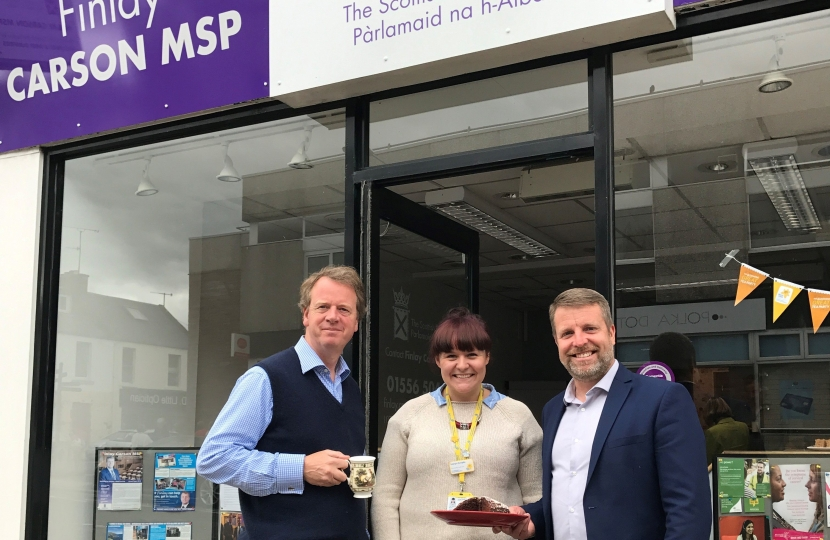 Alister Jack MP attending Finlay Carson MSP's coffee morning for Marie Curie